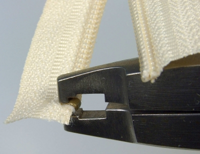 Pressing top stop using Osborne pliers – 3rd view