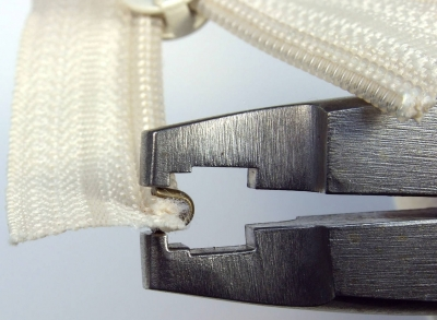 Positioning top stop using Osborne pliers