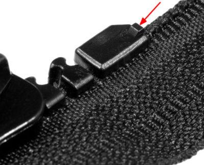 Maschinell angespritztes Anfangsteil auf der Schieberseite eines Reißverschlusses Delrin 9
