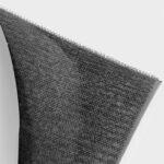 Klettband (Hakenseite) mit Rückseite, Nahaufnahme